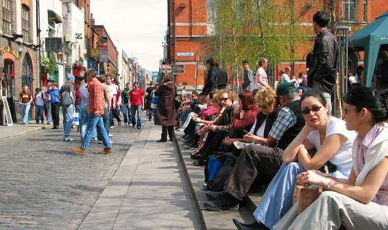 Temple Bar Square crowded on a summer's Day facing north