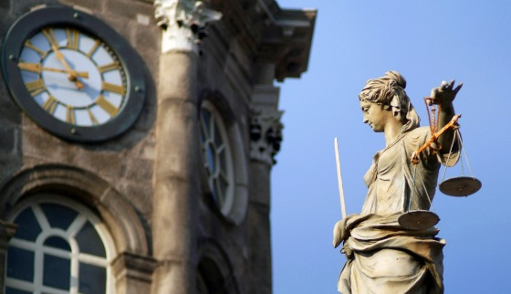 Close up of Clock Tower and Justice Statue at Dublin Castle